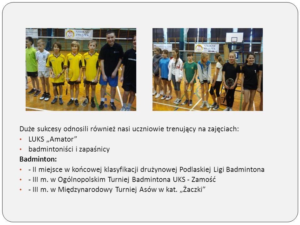 """Duże sukcesy odnosili również nasi uczniowie trenujący na zajęciach: LUKS """"Amator"""" badmintoniści i zapaśnicy Badminton: - II miejsce w końcowej klasyf"""