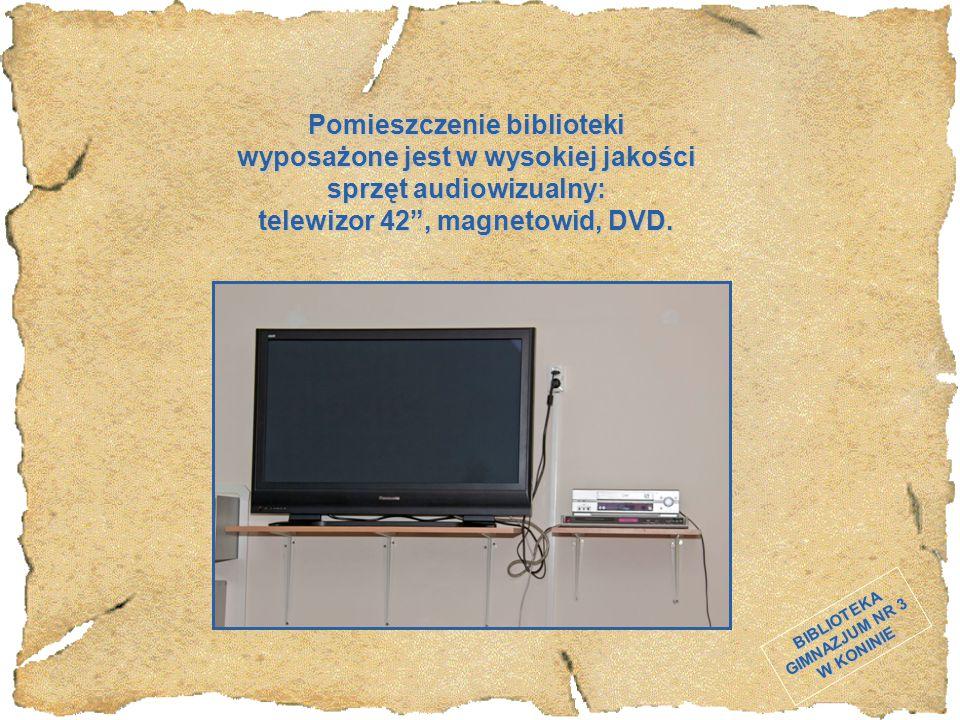 """BIBLIOTEKA GIMNAZJUM NR 3 W KONINIE Pomieszczenie biblioteki wyposażone jest w wysokiej jakości sprzęt audiowizualny: telewizor 42"""", magnetowid, DVD."""